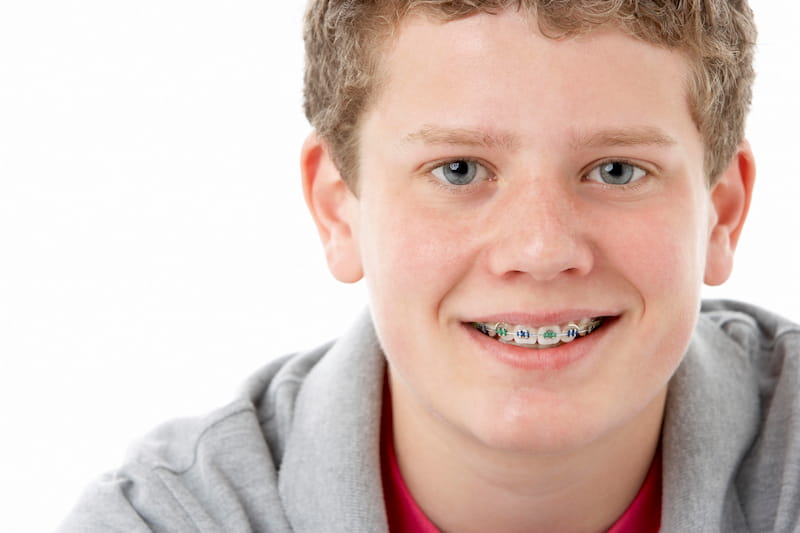 Smiling Teenage Boy with Braces at Orthodontist